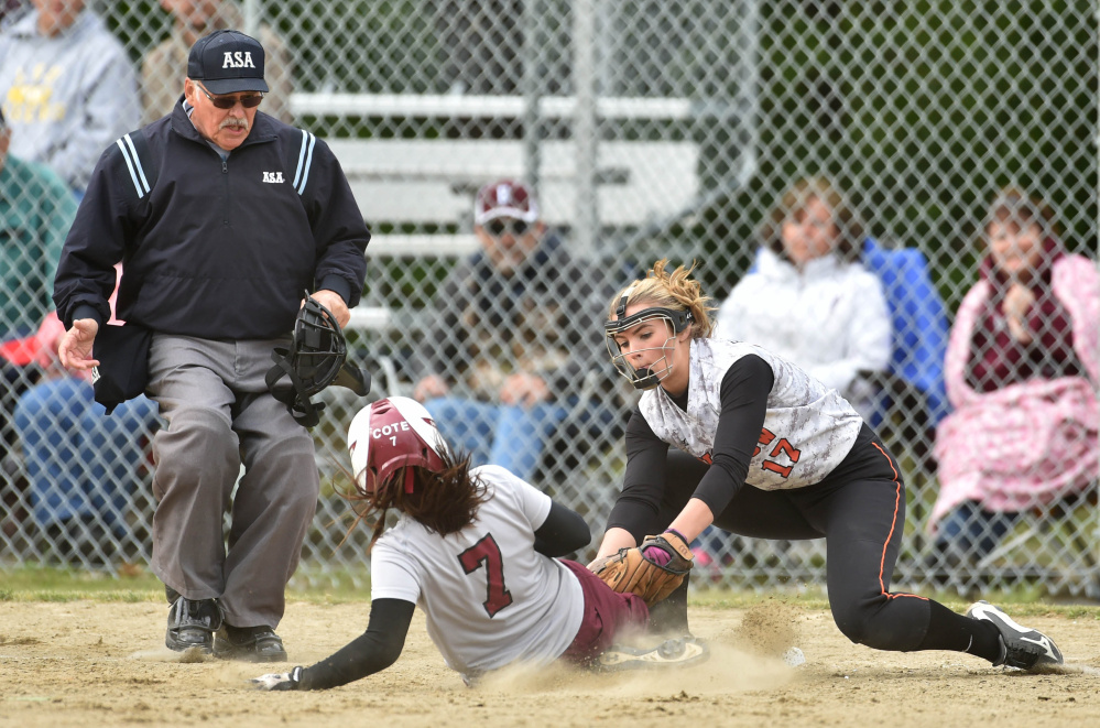 Winslow's Paige Veilleux (17) tags out Ellsworth's Shelby Cote (7) at third base in a Class B North quarterfinal game Thursday in Winslow.