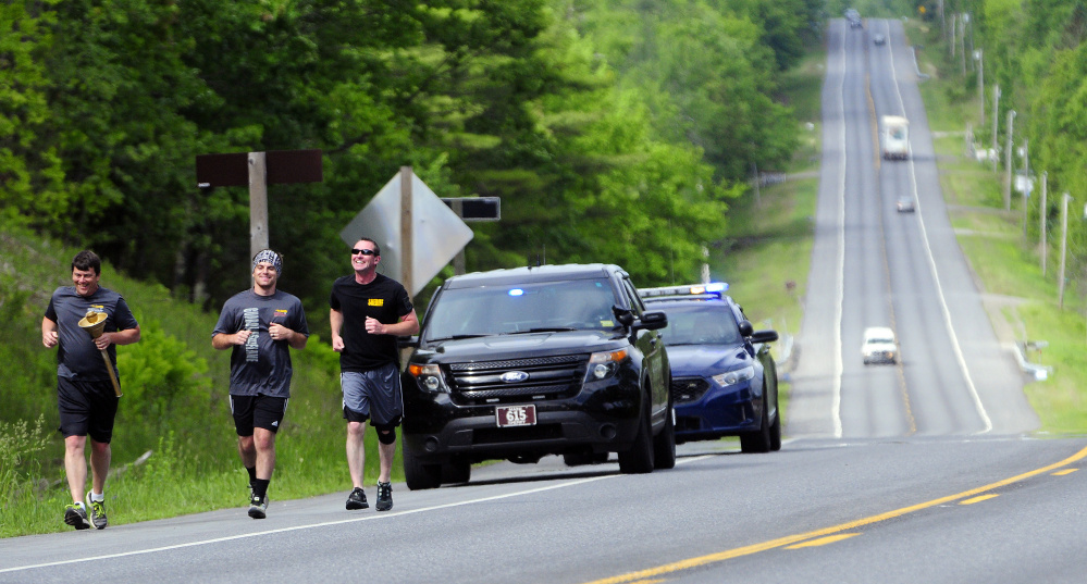 Law enforcement officers took part in the annual torch run for Special Olympics on Thursday, a prelude to the Special Olympics Maine State Summer Games meet this weekend in Orono.