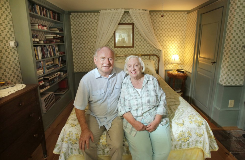 John and Kathy Daamen sit in a room they'd like to use for guests at the Waldo Emerson Inn in Kennebunk. The town's current zoning limits them to renting just four rooms.