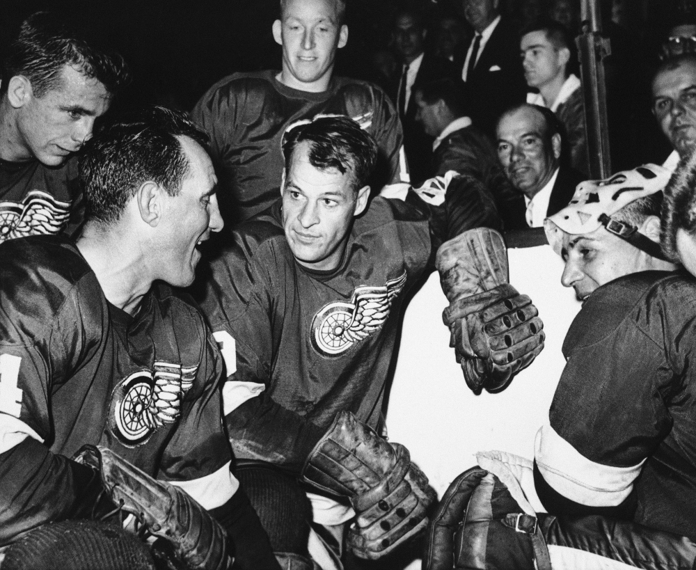 Detroit Red Wings star forward Gordie Howe is surrounded by teammates as he kneels after scoring his 544th goal to tie the National Hockey League all-time record, in Detroit. From left are Larry Jeffrey, Bill Gadsby, Howe, and Terry Sawchuck. Behind Howe is Alex Faulkner. Gordie Howe, the hockey great who set scoring records that stood for decades, has died at 88.