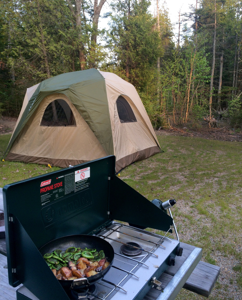 The campsites at Schoodic Woods Campground are considered by many campers to be spacious and well hidden by trees. But the sounds of lobster boats plying their trade are not far away.