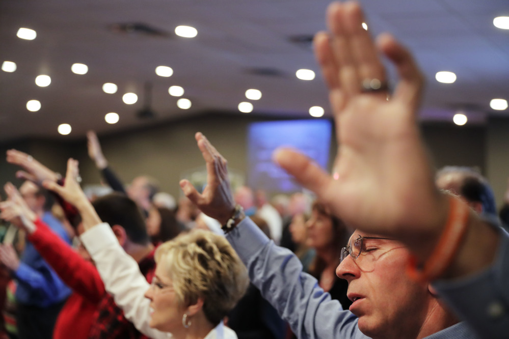 Parishioners pray during a service at the Christian Fellowship Church in Benton, Ky. Religious conservatives could once count on their neighbors to at least share their view of marriage, but public opinion on same-sex relationships has changed.