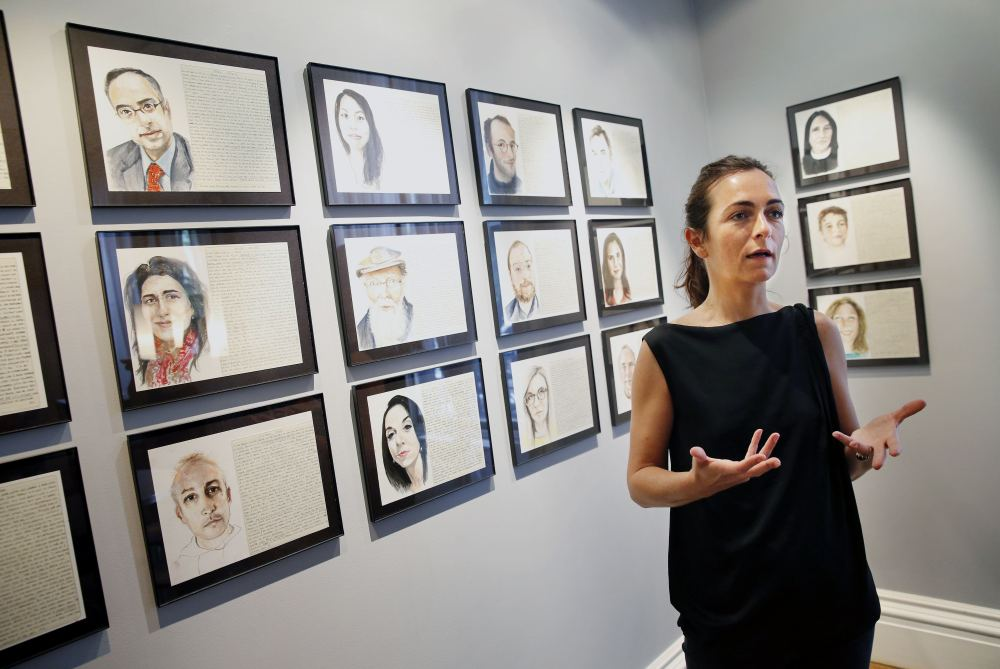 "Aurelie Galois talks about her art at the French Cultural Center in Boston. Each Friday for a year, she painted a stranger's portrait. ""When you move to the U.S., you think you know the American culture but you don't ..."" she said. ""Every person broke down a stereotype."""