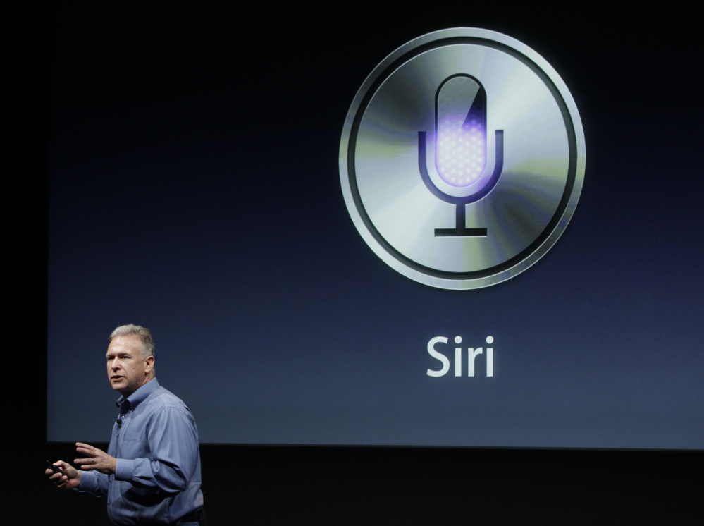 In this Oct. 4, 2011, file photo, Apple's Phil Schiller talks about Siri during an event at Apple headquarters in Cupertino, Calif. Apple's Siri made a big splash when it debuted in 2011.