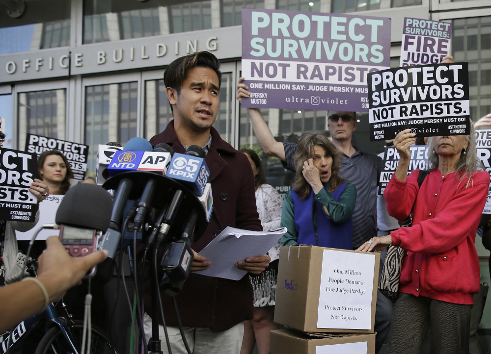 Sexual assault victim Chris Huqueriza speaks at a rally Friday in San Francisco before more than 800,000 signatures were delivered to the Commission on Judicial Performance in a symbolic call for the removal of Judge Aaron Persky from the bench.