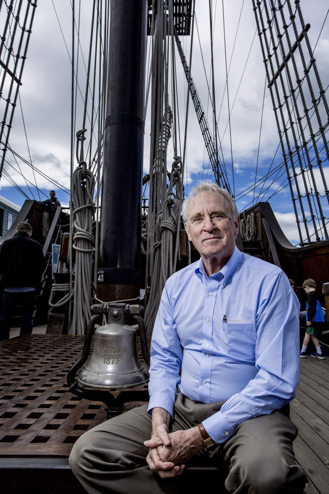 Aboard the Spanish tall ship El Galeon, Tom Cox poses with the bell he bought at a Wiscasset antiques store in 1979. He uncovered its origin as part of the 1899 wreck of a Spanish ship on a reef near Bermuda.