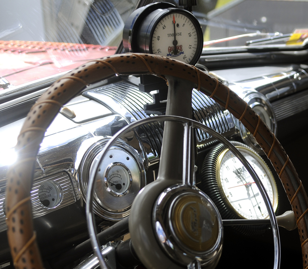 The steering wheel and dashboard of Peter Prescott's 1948 Ford sedan.