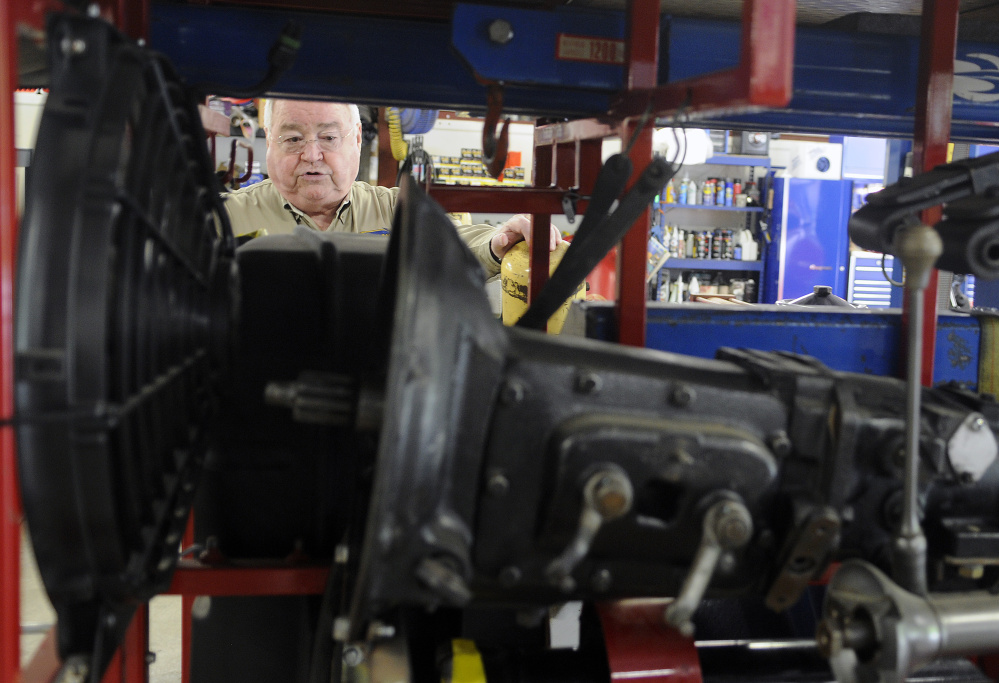 At his Gardiner garage on Thursday, Peter Prescott inspects the extra engine and auto components that will accompany his team and car across the western United States during the 2016 Hemmings Motor News Great Race.