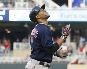 Boston's Xander Bogaerts looks skyward as he heads home after hitting a three-run home run off Twins pitcher Tyler Duffey in the fifth inning Friday night in Minneapolis.