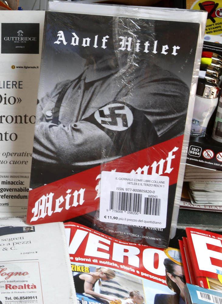 """Il Giornale is on sale Saturday at a Rome newsstand with Adolf Hitler's """"Mein Kampf,""""  drawing heavy criticism from Jewish groups."""