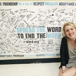 """Meredith Hawkins,  a graduating senior at Yarmouth High School, sits by a banner signed by her fellow students that raises awareness of the harmful effects of the word """"retard"""" in the school community and beyond. Meredith has started a number of school programs to promote understanding and inclusion of students with developmental disabilities. Jill Brady/Staff Photographer"""