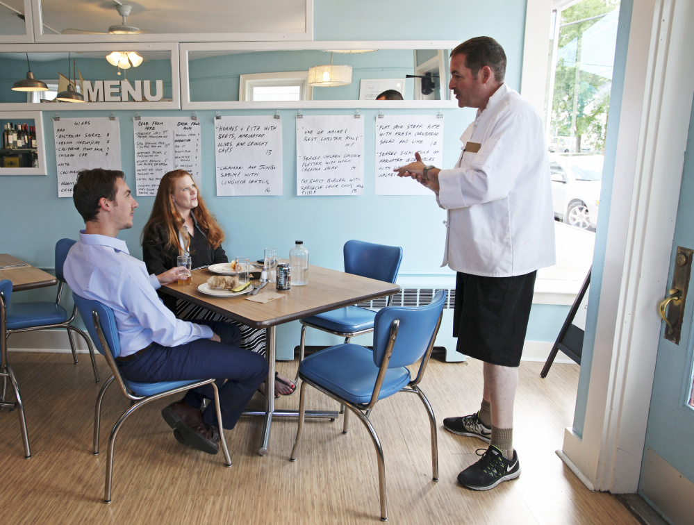 Bill Clifford talks with dinner customers Marissa Brawn and Ben Pottier of Portsmouth, N.H.