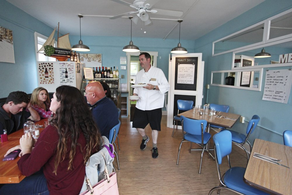 Bill Clifford serves a table of six at Bill's Original Kitchen (BOK) in Kittery.