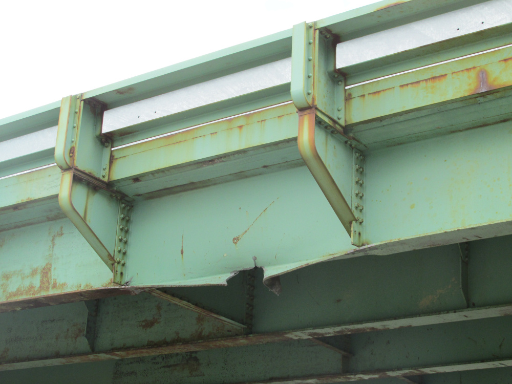 This bridge overpass at Exit 45 of the Maine Turnpike was damaged Tuesday when it was struck by an excavator that was being towed.