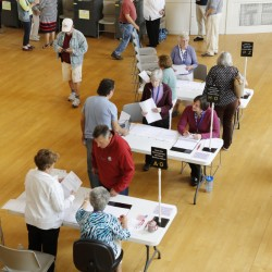 Kennbunk residents vote Tuesday at the Town Hall Auditorium. Residents of Regional School Unit 21, which includes Kennebunk, Kennebunkport and Arundel, approved a proposed $43 million education budget.