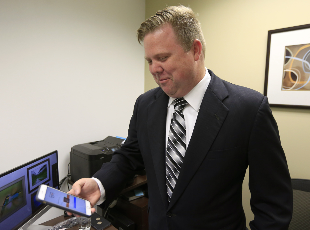 Attorney Rick Davis accesses his chat room while in his office in Leawood, Kansas. Davis uses texts and chat to communicate with his clients, and enjoys the freedom from small talk.