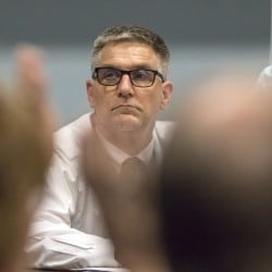 Then-Superintendent Frank Sherburne scans the SAD 6 board last month as it votes to accept the summary of an investigation into the hiring of his son as an education technician.