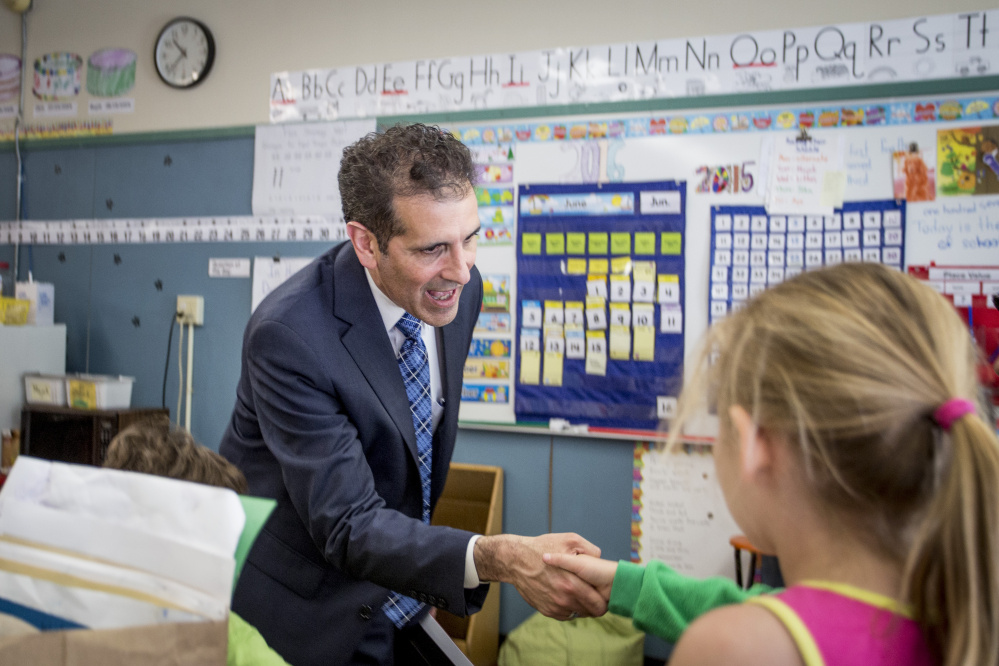 Xavier Botana, the new superintendent of Portland schools, greets students as he tours Hall Elementary School on Thursday.