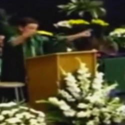 Jack Aiello entertains the audience at his 8th-grade graduation in Arlington Heights, Illinois, with his impersonations of politicians.