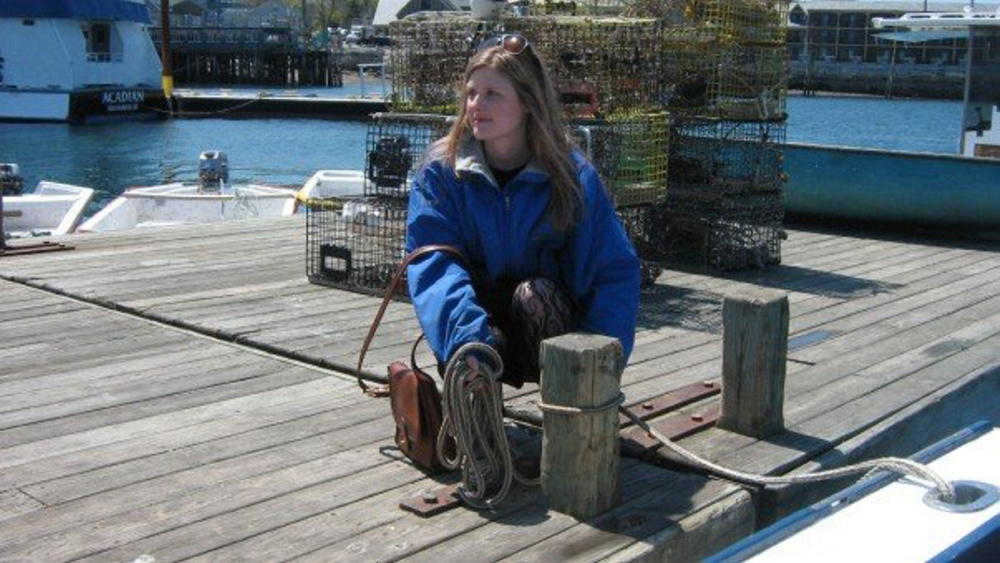 Anna Noyes on a dock in Bar Harbor.
