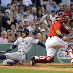Seattle's Ketel Marte slides past Red Sox catcher Sandy Leon to score on a double by Franklin Gutierrez during the fourth inning of Friday's game at Fenway Park. The Mariners won, 8-4.
