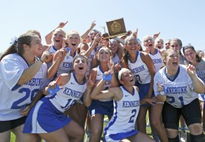 Kennebunk celebrates after defeating Yarmouth in the Class B girls' lacrosse state championship game Saturday at Fitzpatrick Stadium.