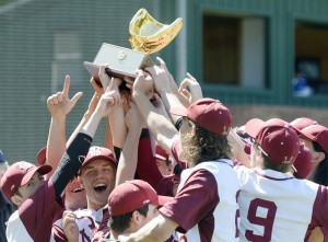 Bangor celebrates with the trophy after defeating Falmouth 5-0 to win the Class A baseball state championship Saturday at St. Joseph's College in Standish.