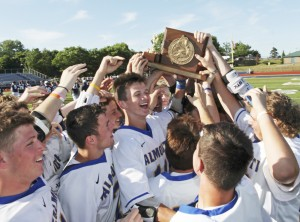 Falmouth celebrates its win over Yarmouth in the Class B boys' lacrosse state championship on Saturday at Fitzpatrick Stadium in Portland.