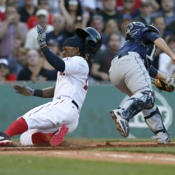 Hanley Ramirez slides into home to score from second on a throwing error ahead of the throw to Seattle catcher Steve Clevenger during the eighth inning of Boston's 6-2 win Saturday at Fenway Park.