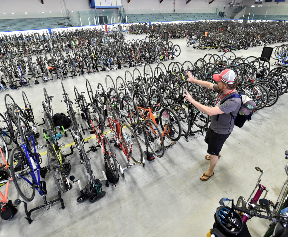 A Trek Across Maine rider stashes his bicycle in Alfond Arena at Colby College after a day of riding from Farmington to Waterville in the 2016 event.