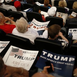 Supporters wait for Republican presidential candidate Donald Trump on Saturday in Las Vegas. Hillary Clinton leads in polls.