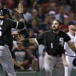 Chicago's Adam Eaton (1) and Avisail Garcia celebrate after both scored on a double by Jose Abreu off Red Sox closer Craig Kimbrel, rear right, in the 10th inning Monday night at Fenway Park. The runs gave the White Sox a 3-1 win, with Kimbrel taking the loss.
