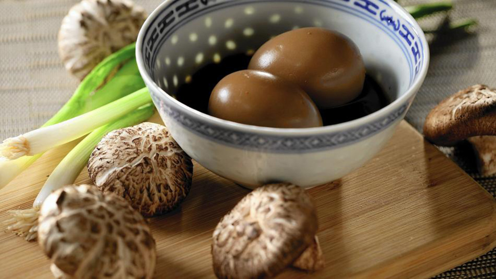 Shiitake mushroom caps and soy-wasabi hard-cooked eggs are favorite elements to add to a bowl of ramen noodles.