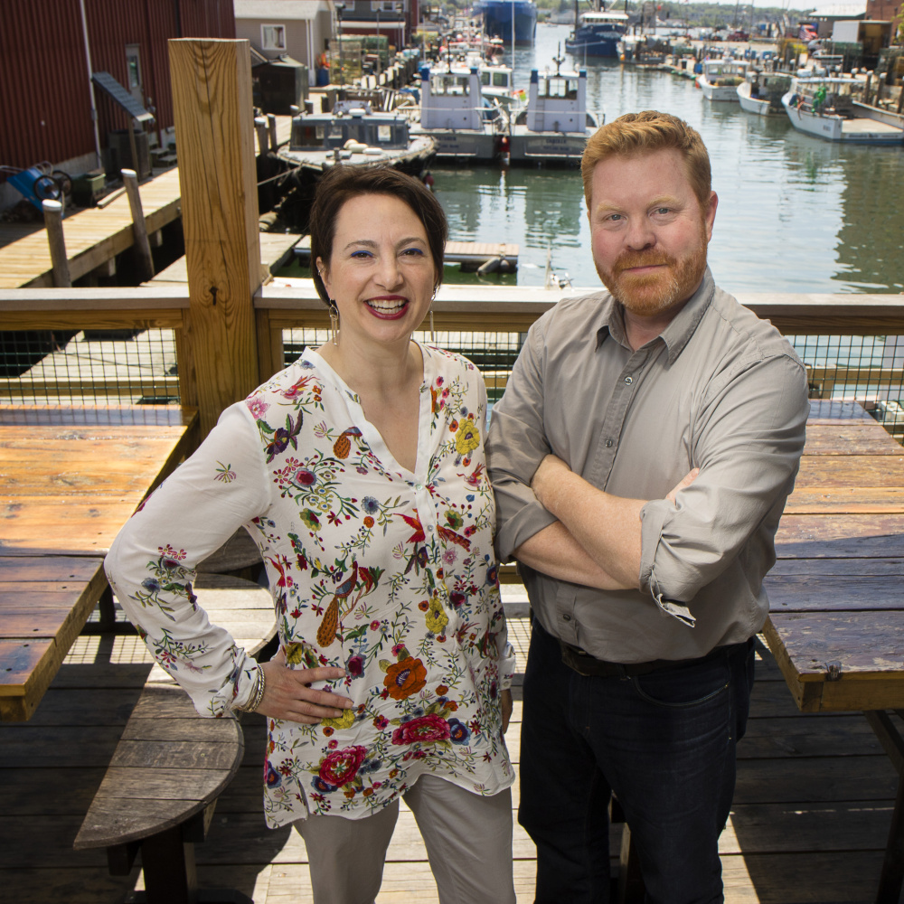 Gillian and Jim Britt, on Portland's waterfront outside one of their clients' businesses, do public relations work for several restaurants and food events.
