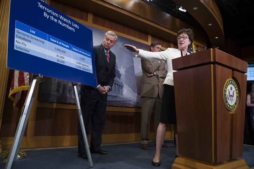 """Sen. Susan Collins, R-Maine, accompanied by Sen. Lindsey Graham, R-S.C., left, and Sen. Martin Heinrich, D-N.M., behind Collins, uses a chart Tuesday to indicate the number of people who would be affected by her proposed """"no fly, no buy"""" restriction on firearm sales."""