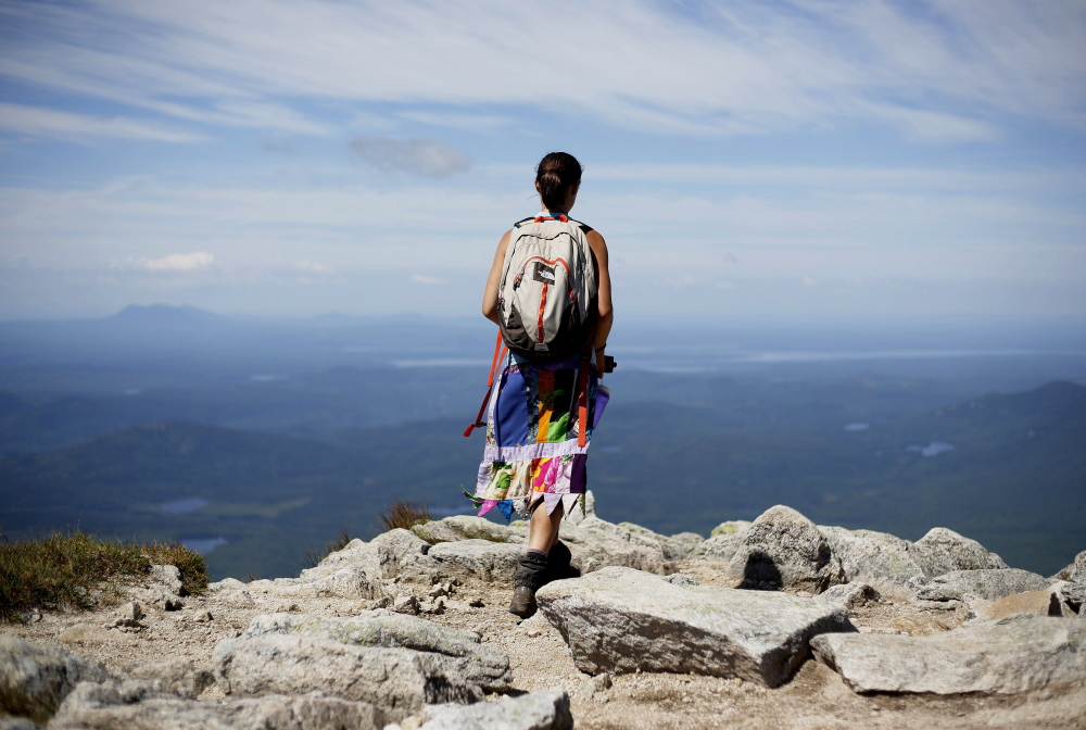 Sarah Morse of North Berwick takes in the view near the summit of Mount Katahdin, the northern terminus of the Appalachian Trail. The number of thru-hikers at Baxter has soared in the past couple of decades, from 359 in 1991 to 2,137 in 2015.