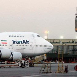 "An Iran Air jet sits near the terminal at Mehrabad International Airport in Tehran in 2003. Boeing says the airline's deal of intent to buy the company's planes was authorized by the U.S. government ""following a determination that Iran had met its obligations under the nuclear accord reached last summer."""