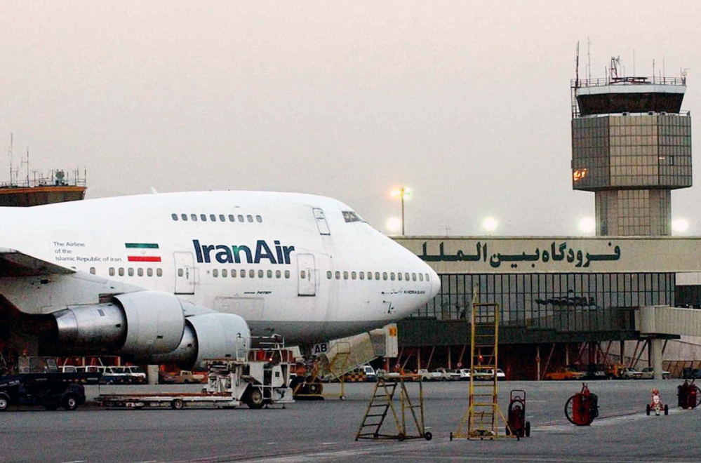 An Iran Air jet sits near the terminal at Mehrabad International Airport in Tehran in 2003. Boeing says the airline's deal of intent to buy the company's planes was authorized by the U.S. government