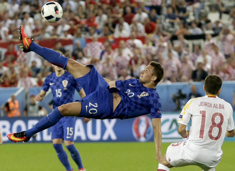 Marko Pjaca of Croatia goes for an overhead kick Tuesday during the Group D game against Spain at Bordeaux, France. Croatia won 2-1 and handed Spain its first loss at the every-four-years tournament since 2004.