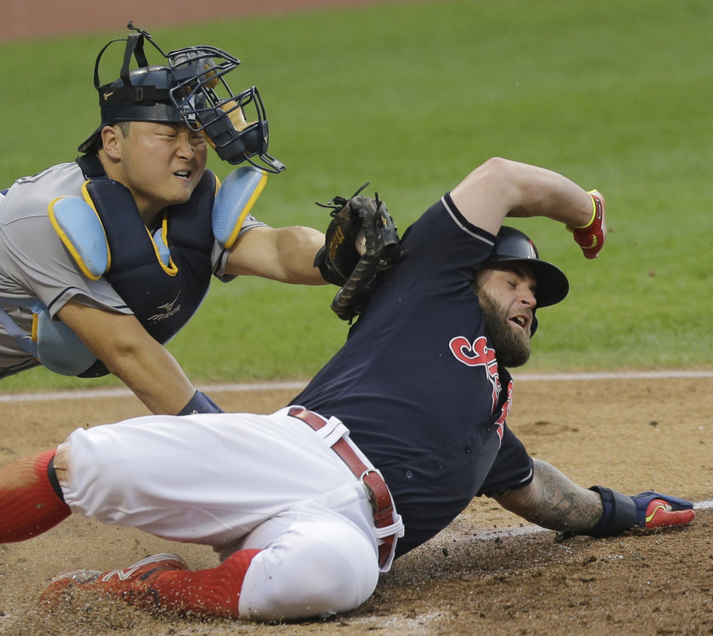 Mike Napoli of the Cleveland Indians is tagged out by Tampa Bay catcher Hank Conger while trying to score from second on a single. Cleveland won, 6-0.