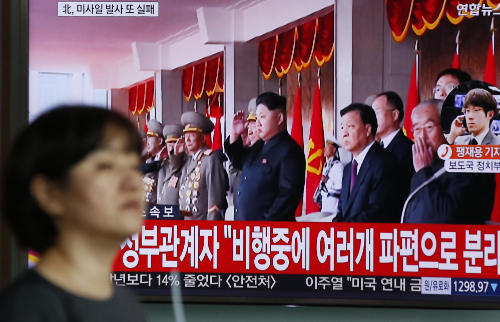 A TV screen in Seoul, South Korea, shows North Korea's leader Kim Jong Un on Wednesday. North Korea has launched a missile about 620 miles high.