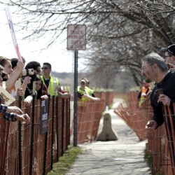 A sidewalk makes an uneasy buffer zone as supporters and opponents of Donald Trump face off outside the Republican presidential candidate's rally this past March in Janesville, Wis.
