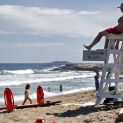 Lifeguards Nate Samson, 18, of Brunswick, left, and Kyle Hummel, 19, of Bath, patrol a section of Mile Beach at Reid State Park on Thursday in Georgetown.