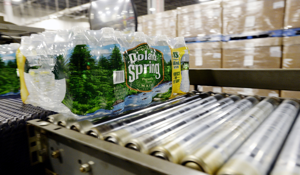Packaged bottles of Poland Spring water on a conveyor belt in the Hollis plant Shawn Patrick Ouellette/Staff Photographer
