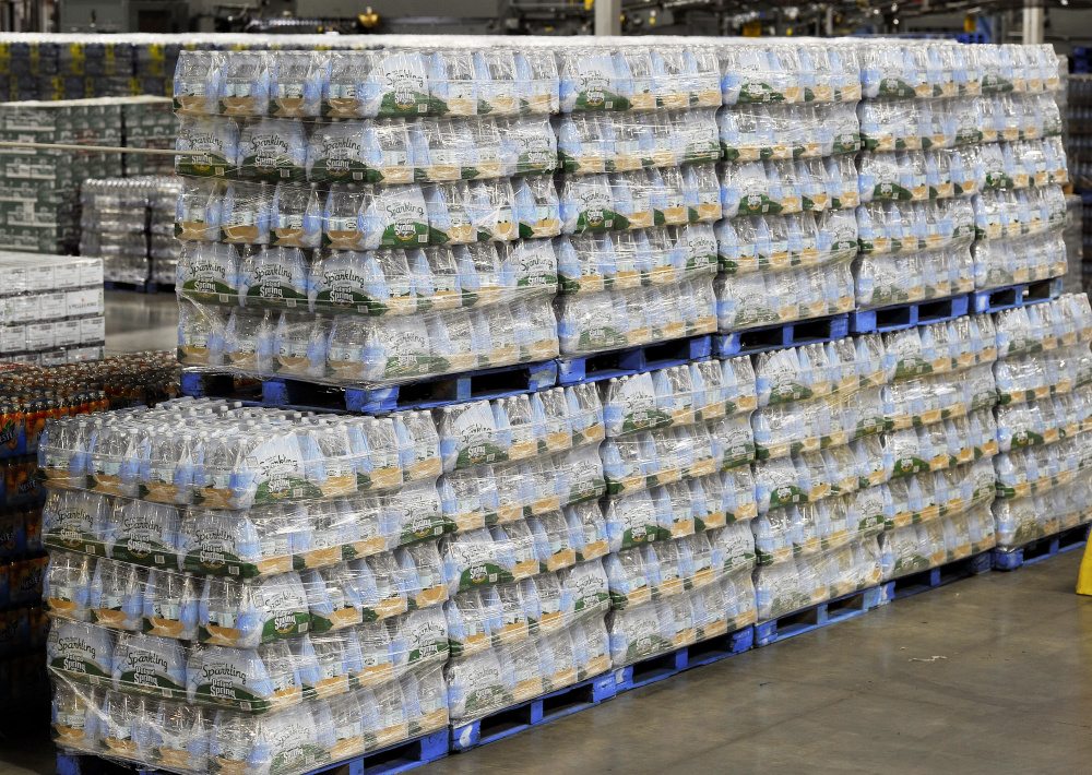 Bottles of Poland Spring water stacked up at the Hollis facility Tuesday Shawn Patrick Ouellette/Staff Photographer