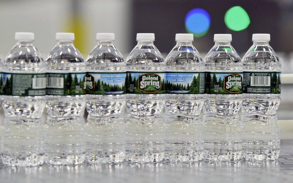 Bottles of Poland Spring water Shawn Patrick Ouellette/Staff Photographer