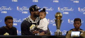 LeBron James, center, sits with his family for a post-game news conference after his Cavaliers won the NBA title on Sunday night. James said Thursday he plans to skip the Olympics in Rio.