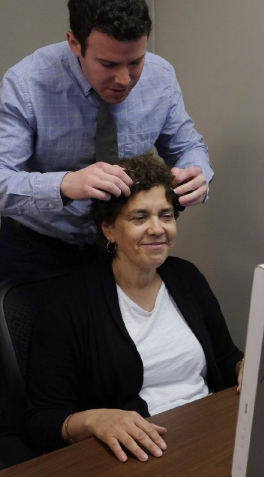 Neuroscientist Ryan McGarry prepares Jennie Litvack, 52, for research at Spark Experience in Maryland. Researchers found that what people feel and what they say they feel are rarely the same.