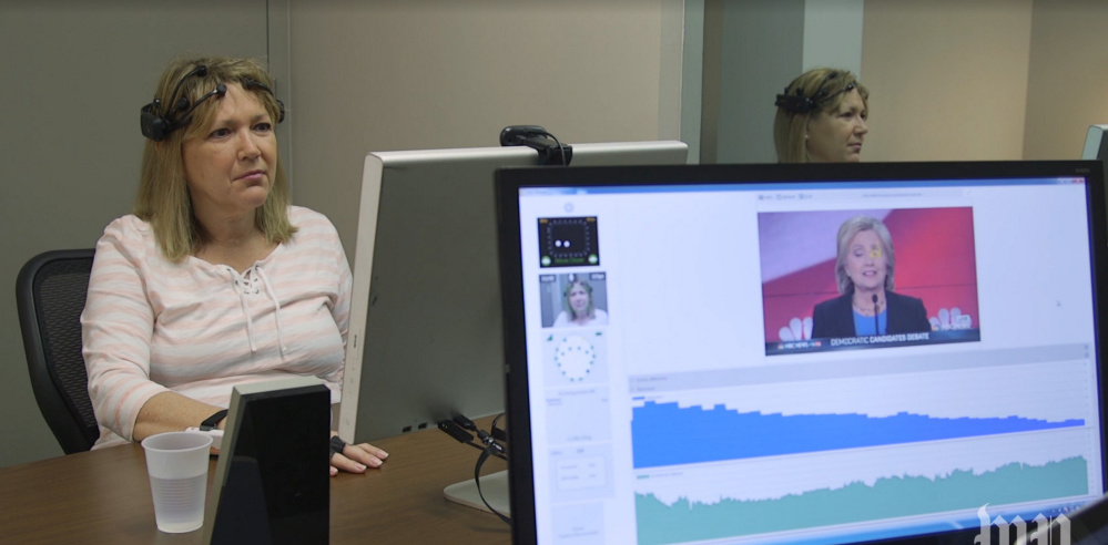 A woman undergoes testing at Spark Experience, a company that gathers four types of physical data to gauge how participants respond to political candidates. The data measure emotions and the participants' intensity of attention.