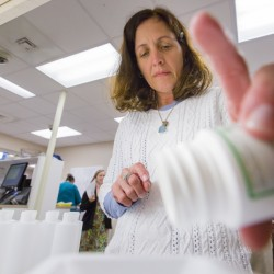 "Patrice Carter, a pharmacist at Kennebec Pharmacy in Brunswick, prepares a compound that's used to treat rashes caused by browntail moth caterpillars. ""I can mix the compounds in my sleep. There has been a tremendous demand,"" Carter said."